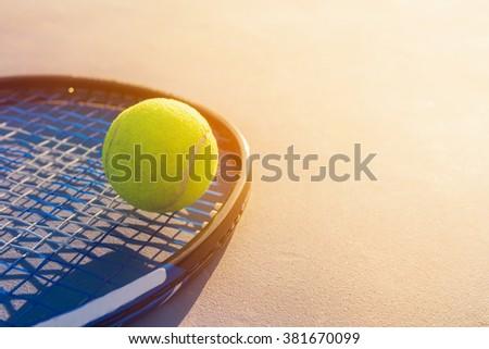 Tennis Ball and Racket. green color tennis ball. single tennis ball. tennis ball from Thailand. tennis ball vivid tone. the new tennis ball. beautiful tennis ball. Tennis ball on a tennis court - stock photo