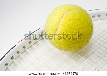tennis ball and racket in  macro mode - stock photo