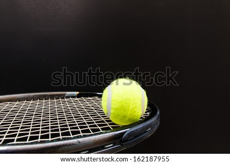 Tennis Ball and Racket isolated with black - stock photo