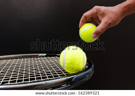 Tennis Ball and Racket isolated with black