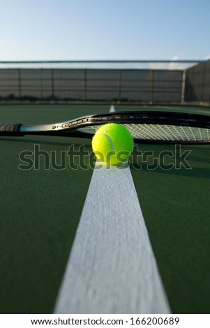 Tennis Ball and Racket on the Court Line - stock photo