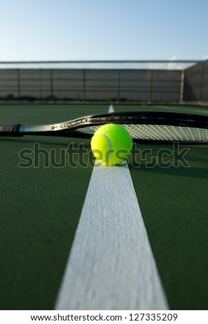 Tennis Ball and Racket on the Court Line with room for copy