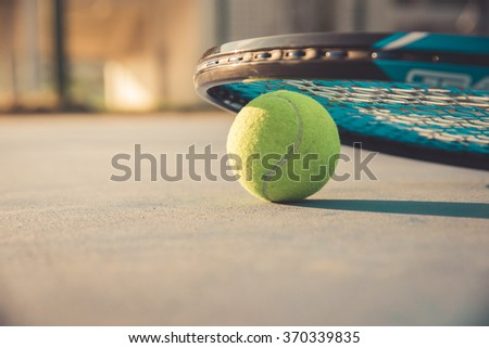 Tennis Ball and Racket , vintage tone - stock photo