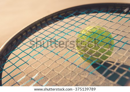 Tennis Ball and Racket , vintage tone - stock photo
