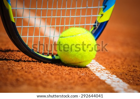 Tennis Ball and Racquet on the court - stock photo