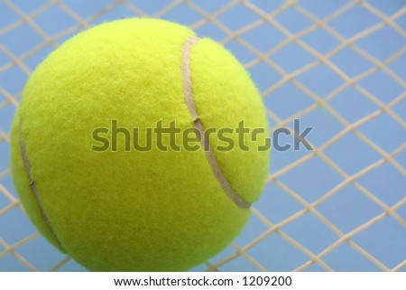 Tennis ball and tennis racquet