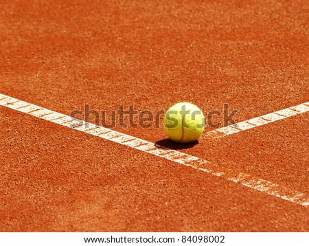 tennis ball at the t line in the tennis court - stock photo