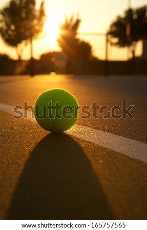 Tennis Ball Backlit at Sunset for Effect and Glow - stock photo