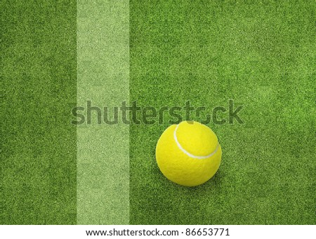 tennis ball beside the court line. - stock photo