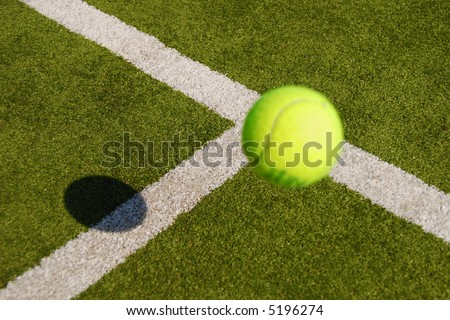 Tennis ball close to the service line - stock photo