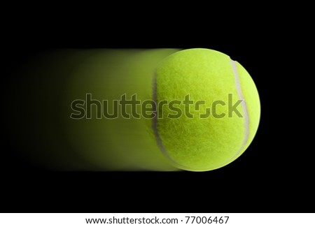 Tennis ball fast moving on black background - stock photo