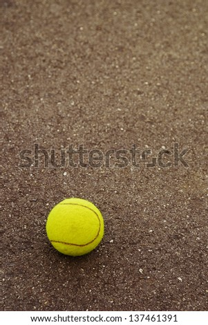 Tennis ball hitting the ground for a point. - stock photo