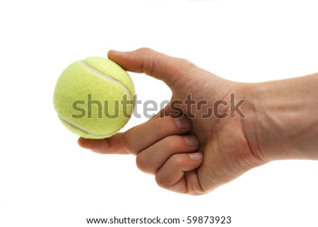 Tennis ball in hand isolated on white