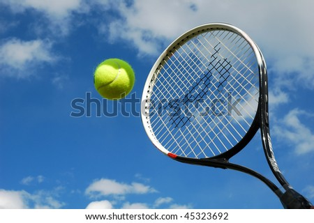tennis ball in mid-flight - stock photo