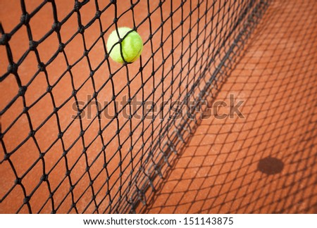 tennis ball in net background - stock photo