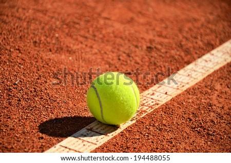 tennis ball is on the markup diagonal closeup horizontal - stock photo