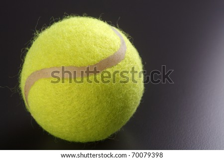 Tennis ball isolated on the black background.