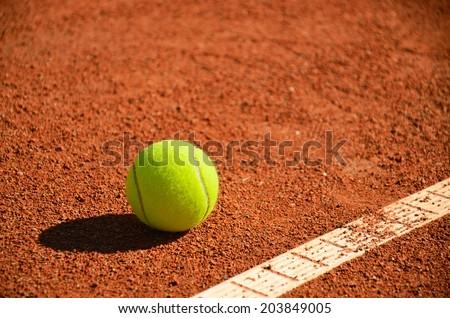 tennis ball near markup diagonal horizontal format - stock photo