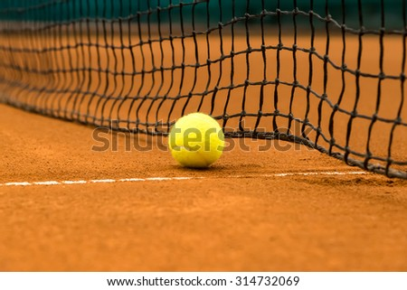 tennis ball on a clay court - stock photo