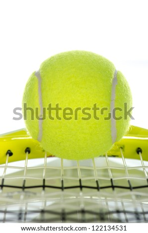 Tennis ball on a racket against a white background