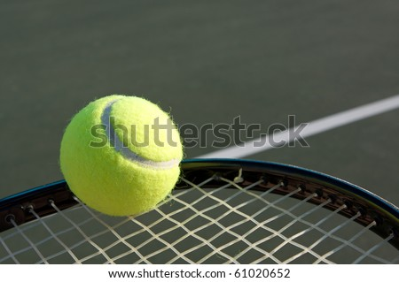 Tennis ball on a racket with room for copy - stock photo