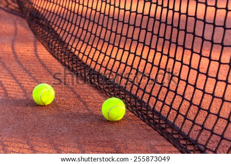 Tennis ball on a tennis clay court - stock photo
