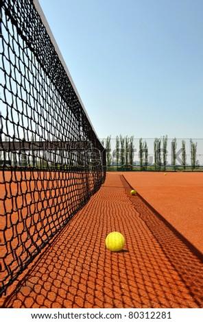 Tennis ball on a tennis clay court - stock photo