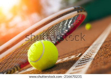 tennis ball on a tennis court - stock photo
