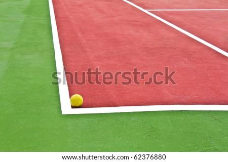 Tennis ball on a tennis court. - stock photo