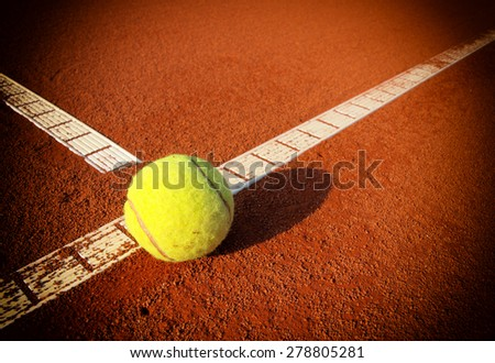 Tennis Ball on a tennis court with copy space - stock photo