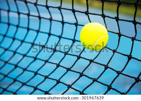 tennis ball on a tennis court with net, sport