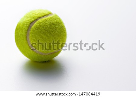 Tennis ball on a white background with copy space conceptual of exercise, sport, health and fitness