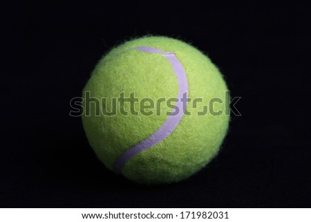 Tennis Ball on Black Background - stock photo