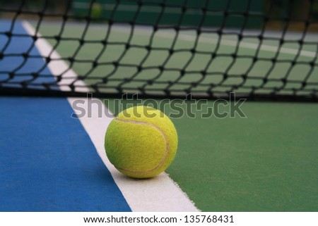 tennis ball on line  ,tennis ball on green blue court and net in sport competition background, sport club concept