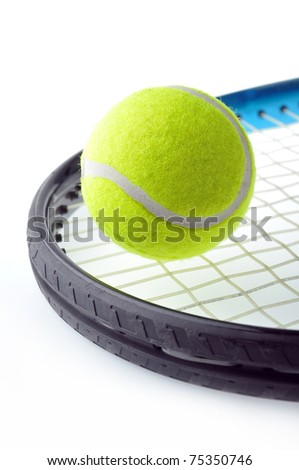 tennis ball on racket and isolated on white background. - stock photo