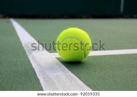 Tennis ball on tennis court - stock photo