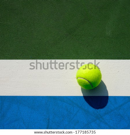 tennis ball on tennis court background - stock photo