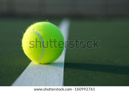 Tennis Ball on the Court Close up with room for copy - stock photo