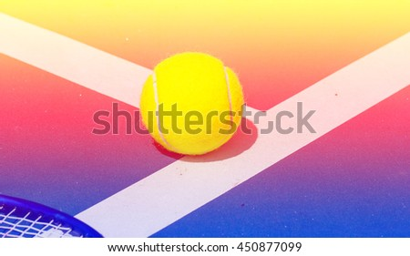 Tennis ball on the court with color filters - stock photo