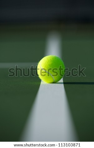 Tennis Ball on the Fading Court Line - stock photo