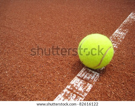 tennis ball on the line 8 - stock photo