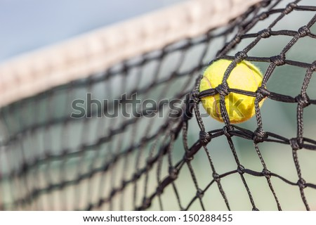 Tennis Ball on the Net - stock photo