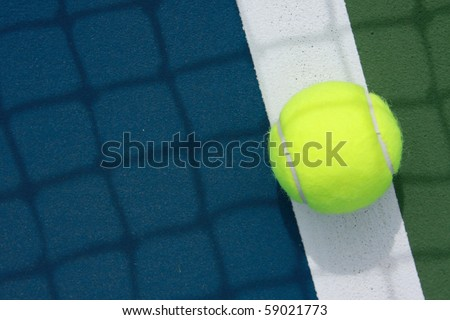 tennis ball on the out line of court - stock photo