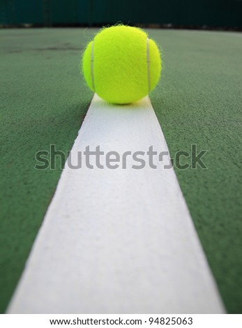 Tennis Ball on the tennis court - stock photo