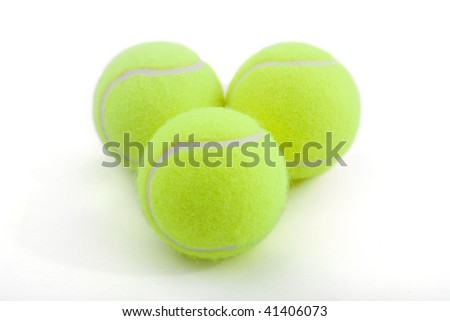 tennis ball on white background. lying by triangle.