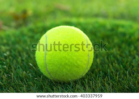 Tennis ball one green background