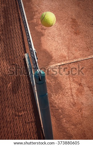 tennis ball over the net - stock photo