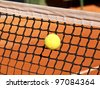 tennis ball stack in the net - stock photo