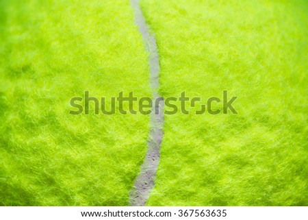 Tennis Ball, Standard Ball, Light Green. Close up Macro Selective Focus. Concept and Idea of Sport, Recreation and Outdoor Activity. Background, Wallpaper and Textures. - stock photo