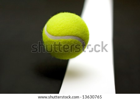 Tennis ball with fading court line - stock photo